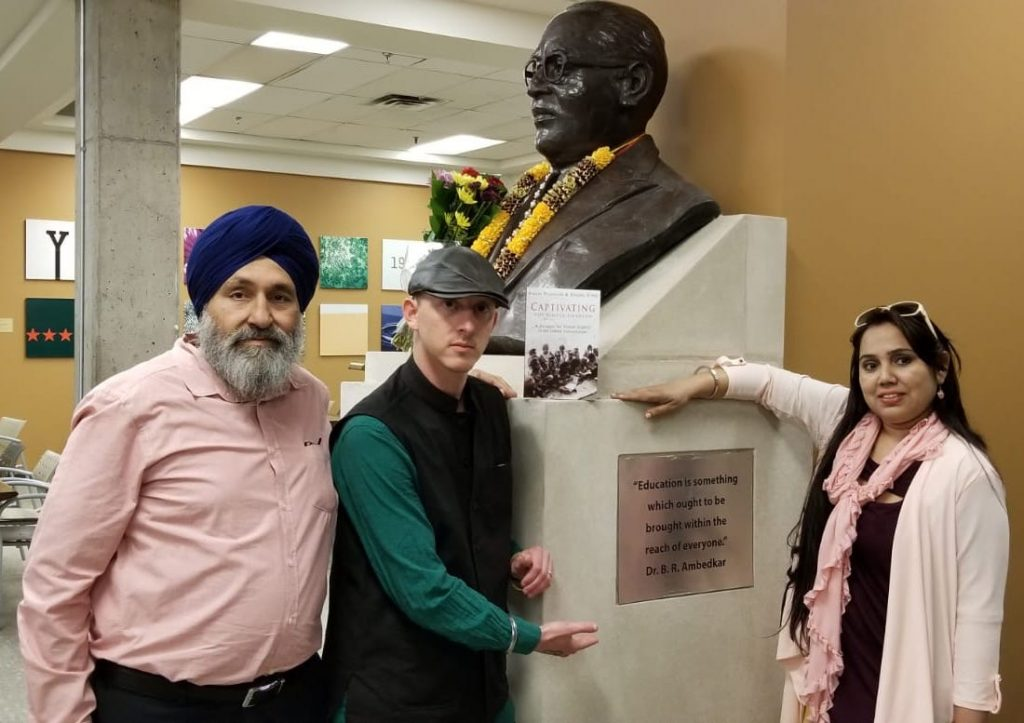 "Presenting ""Captivating"" to Ambedkar bust at York University"